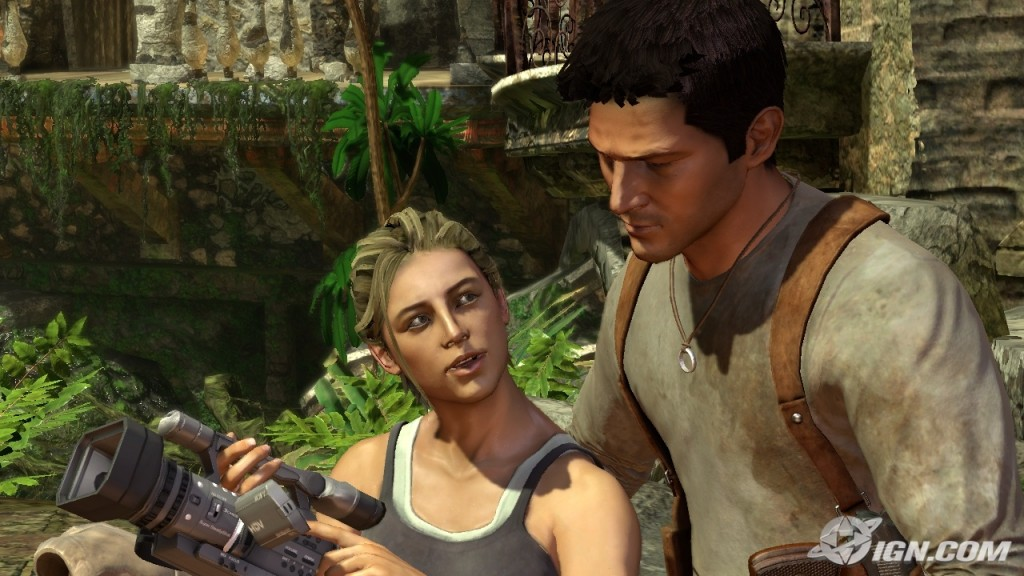Drake and Elena, in a jungle ruin, looking at a camcorder